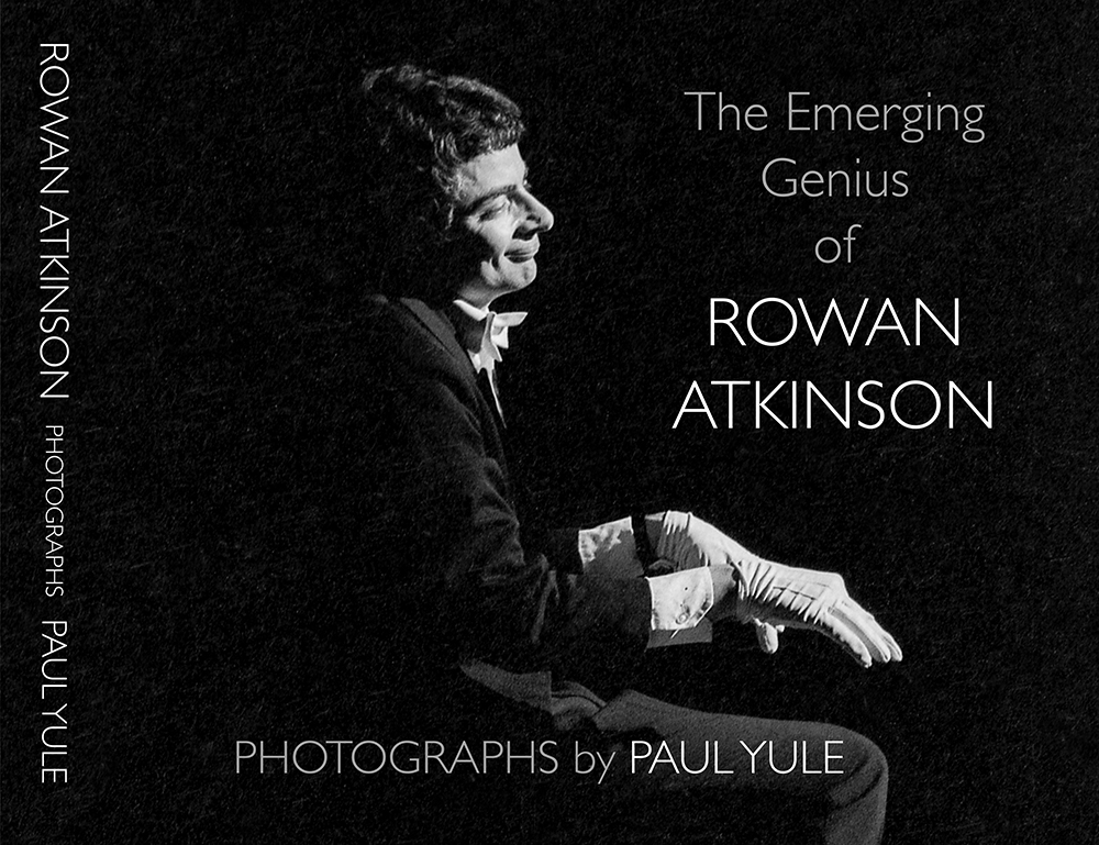 Rowan Atkinson playing the piano
